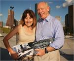 Bill White (Houston Mayor) and his wife Andrea, receiving their Houston Parks Award Skateboard